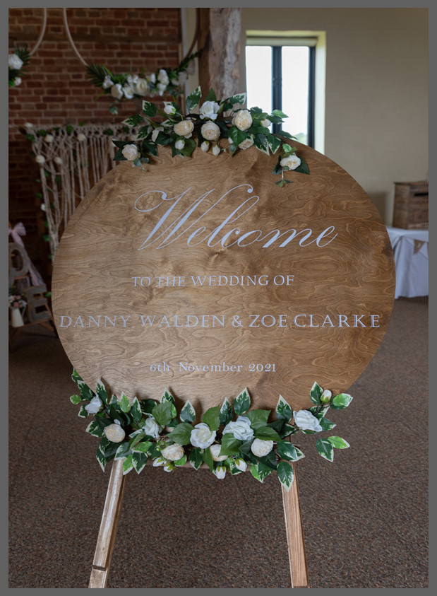rustic welcome sign, birch wooden sign with vinyl writing and drapped in roses and whisteria