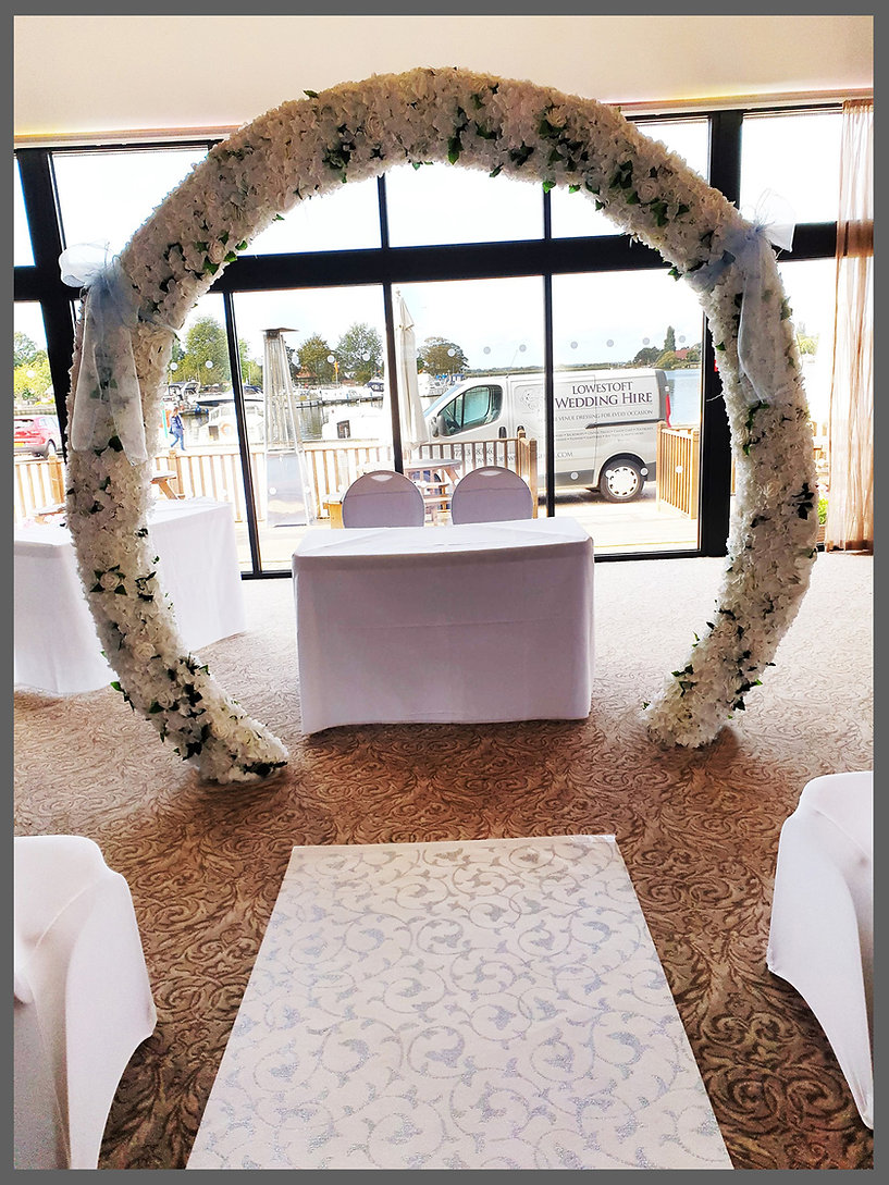 LOWESTOFT, lowestoft wedding hire, flower arch, the wherry hotel, oulton broad, suffolk, norfolk, the broads, waveney wedding, room with a view, outside patio area hotel, chair covers, sashes, wedding day, norfolk brides, suffolk brides, blue wedding day