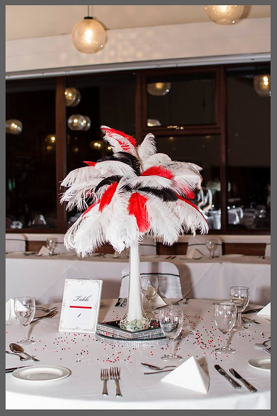 lowestoft wedding hire, rookery park golf club, casion night, vegas wedding theme, ostrich feather centre piece, red wedding