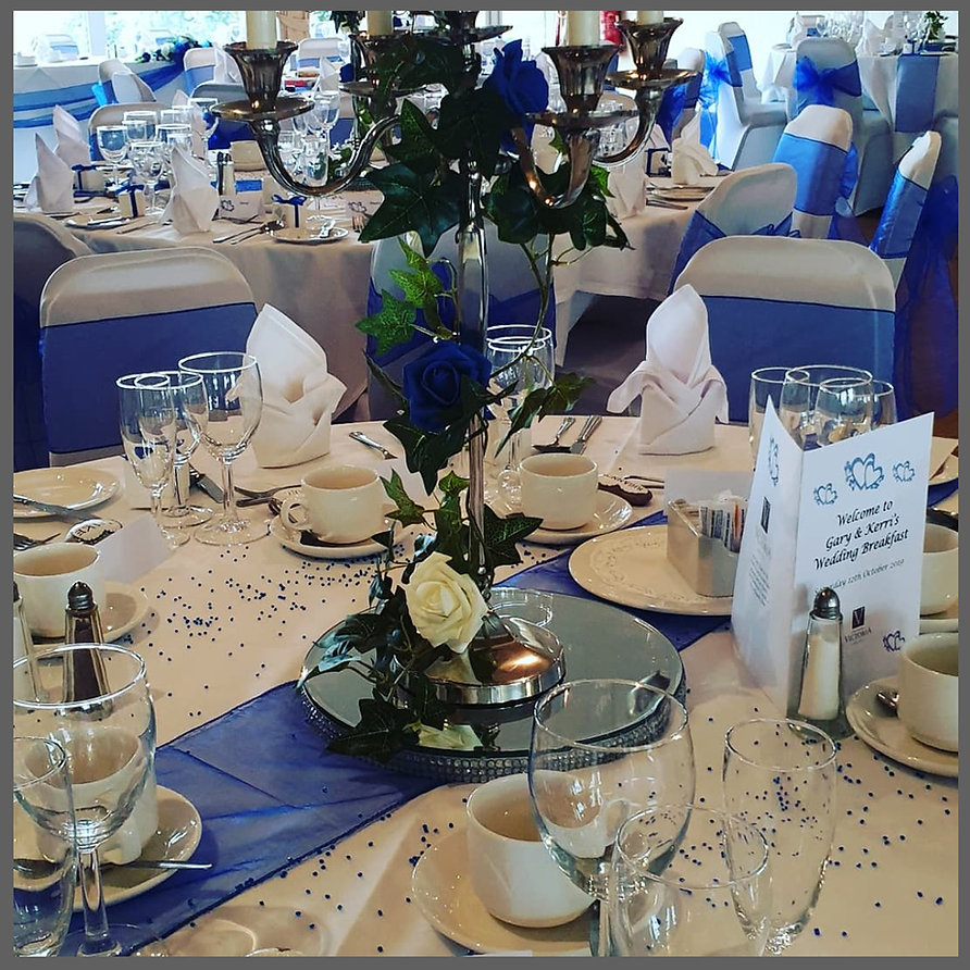 lowestoft wedding hire, norfolk bride, suffolk bride, the hotel victoria lowestoft, candelabra wedding centre piece, table runners, chair covers sashes, organza sashes, silk wedding chairs, charavi chairs, roses, royal blue wedding, mirror plates, wedding day set up7
