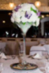 lowestoft wedding hire, lowestoft events, suffolk wedding, norfolk wedding, venue dressing, party decoration, martini vase, mirror plate. round table, table gems, diamond mirror, chair sashes, purple wedding, cadburys wedding, white roses, ivory roses, centre piece, rookery park golf club