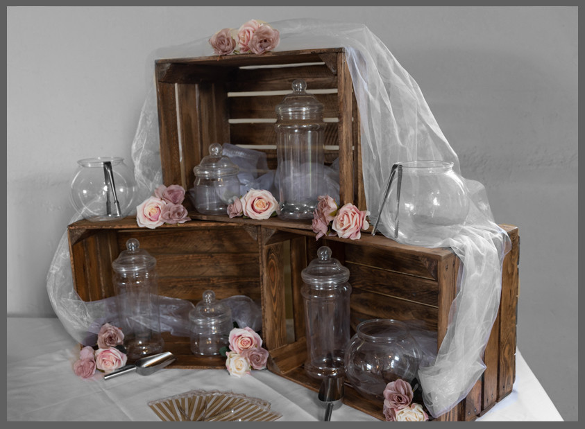 sweet jars stached in crates vintage wedding with organza draped and blush pink roses