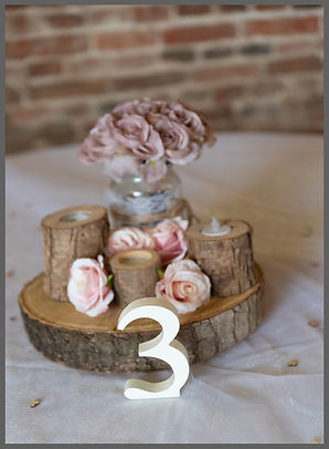 LOWESTOFT WEDDING HIRE, SUFFOLK WEDDING HIRE, NORFOLK WEDDING HIRE, PINK CENTRE PIECE, BARN WEDDING, NUMBER 3 LOG SLICES, CANDLES, WOOD FARM BARNS BENACRE, BECCLES, SOUTHWOLD WEDDING
