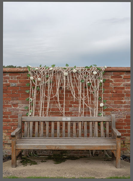lowestoft wedding hire, wood farm barns, benacre, soutlwold beccles, wavaney wedding hire, macrame back drop, hide ugly walls and views with this stunning knotted backdrop in off white with added roses and ivy to fit into all traditional barn and rustic wedding settings, love ladders, love letters, ladder display, milk jugs, flower milk jugs, rustic wedding, barn wedding