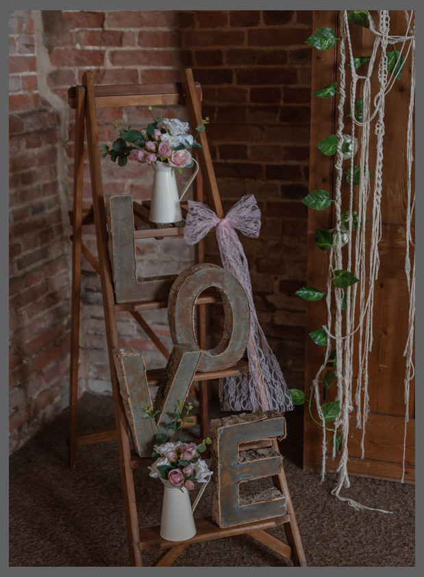 rustic wooden ladders with love detailing vintage milk jug roses and lace detailing