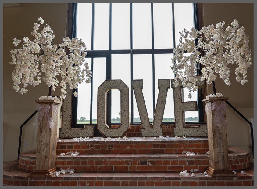 LOWESTOFT WEDDING HIRE, LOVE LETTERS, WOOD FARM BARNS, SUFFOLK WEDDING NORFOLK WEDDING WEDDING HIRE ITEMS, WAVENEY WEDDING HIRE BLOSSOM TREES, LARGE BLOSSOM TREES, RUSTIC WEDDING BLOSSOM TREES, FLOWER FILLED LOVE LETTERS, 4FT LOVE LETTERS, BARN WEDDING RUSTICK WEDDING DAY, BEAUTIFUL HIDDEN VENUE