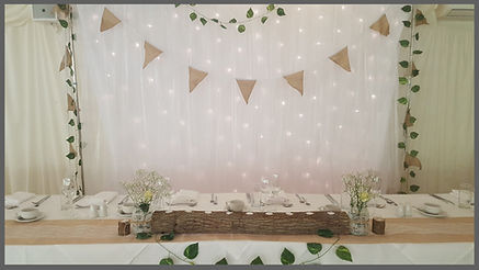 LOWESTOFT WEDDING HIRE, IVY HOUSE COUNTRY HOTEL, SUFFOLK VENUE, NORFOLK VENUE, TOP TABLE CENTRE PIECE, FRESH FLOWERS, WEDDING GOALS, STAR LIGHT BACKDROP, BUNTING, IVY TEALIGHTS AT WEDDINGS