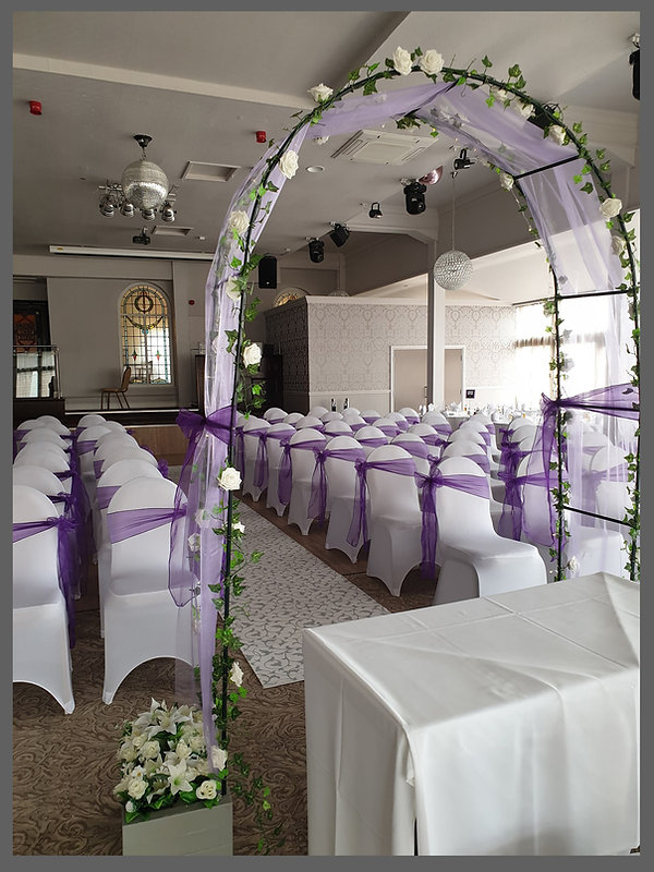 LOWESTOFT WEDDING HIRE, THE WHERRY HOTEL WEDDINGS OUTLON BROAD, SUFFOLK WEDDINGS, NORFOLK WEDDINGS, NORWICH WEDDINGS, BECCLES, GREAT YARMOUTH, PURPLE WEDDING DAY, WEDDING DAY ARCH, WEDDING ARCH, STAINED GLASS WINDOW, DISCO BALL, CHAIR COVERS, CHAIR SASHES, WEDDING DAY GOALS, MARRIED AT A HOTEL