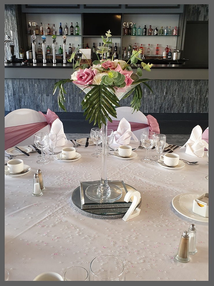 LOWESTOFT WEDDING HIRE LTD, THE HOTEL VICTORIA, SUFFOLK HOTEL, WEDDING VENUE SUFFOLK, NORFOLK BRIDE, BLUSH PINK WEDDING DAY, PERFECT PINK WEDDING, CENTRE PIECE, TROPICAL CENTRE PIECE, CHAIR SASHES