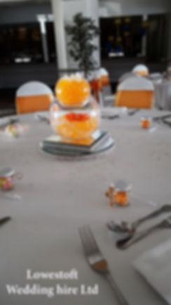 lowestoft wedding hire, venue decorations, norfolk wedding, suffolk wedding venue decoration, venuedressing party hire, party decorations, orange wedding, centre pieces, mirrorplates, diamond wedding, tablegems wedding flowers, table setting, carlton manorhotel, table gems, knife and folk, weddng favours,