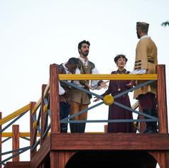 Rosencrantz (Tolu Ekisola), Guildenstern (Shaan Sharma), Gertrude (Margie Catov), and Claudius (Martin Andrews)