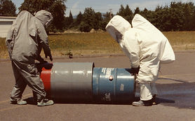 HazMat responders overpacking leaking hazardous materials drum - training and emergency response planning