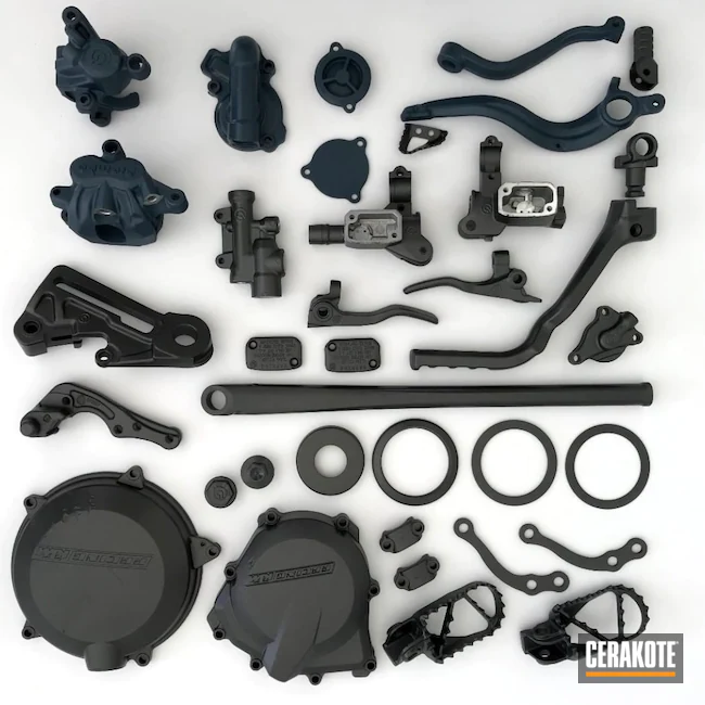 dirt-bike-motorcycle-parts-cerakoted-using-tungsten-and-blue-titanium.webp