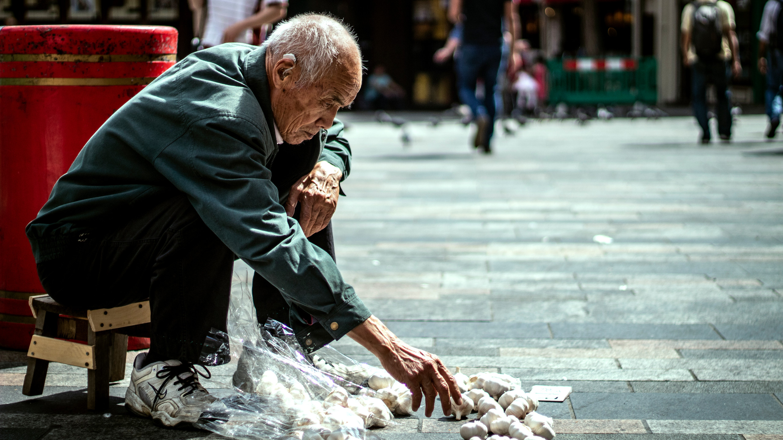 A local man selling cloves of garlic