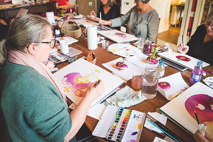 Students learning to paint watercolour with The Creative Olive
