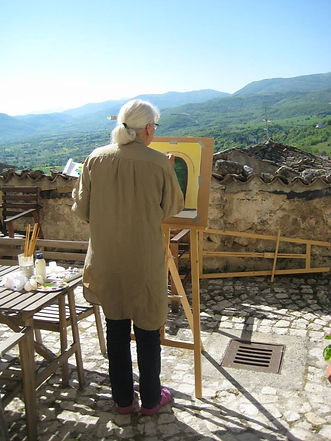 woman painting landscape in Italy