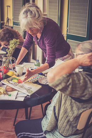 Trine PEttigrew teaching students to paint