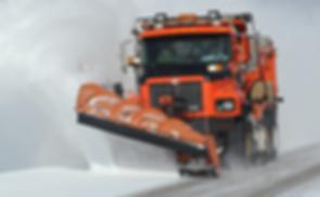 Plow truck plowing snow