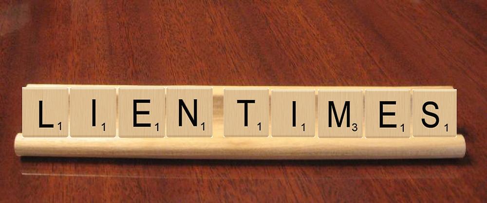 Scrabble blocks spelling LIEN TIMES