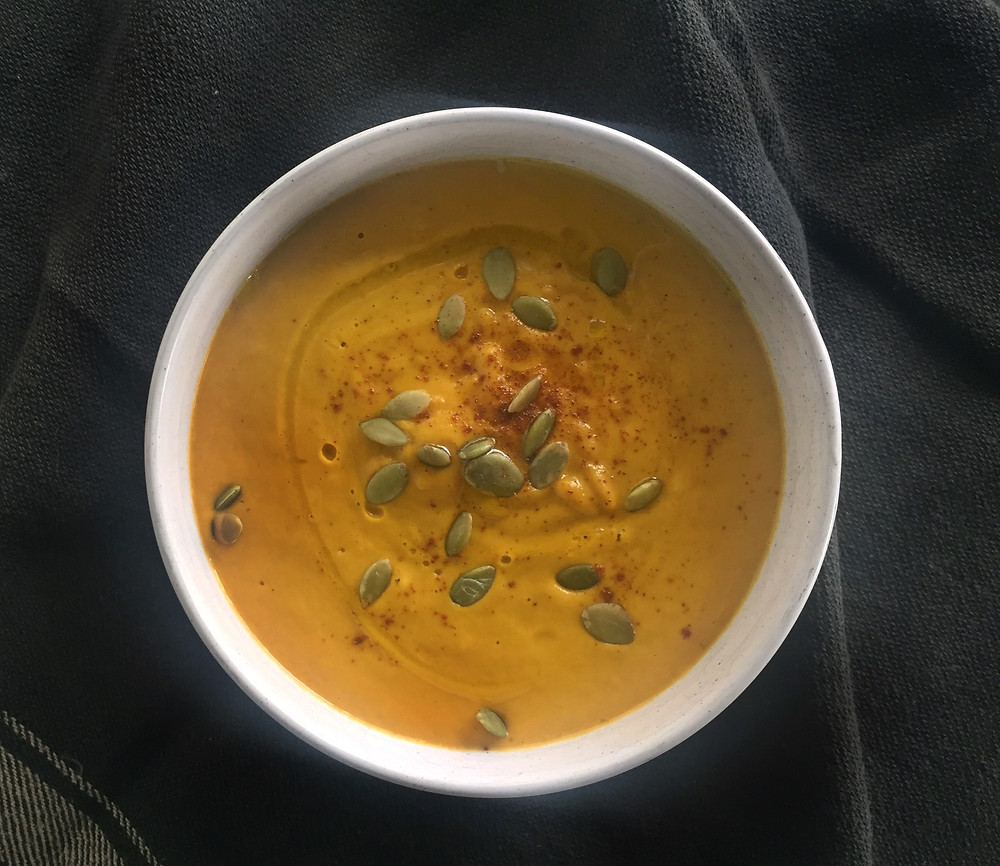 Kumara and carrot soup in bowl