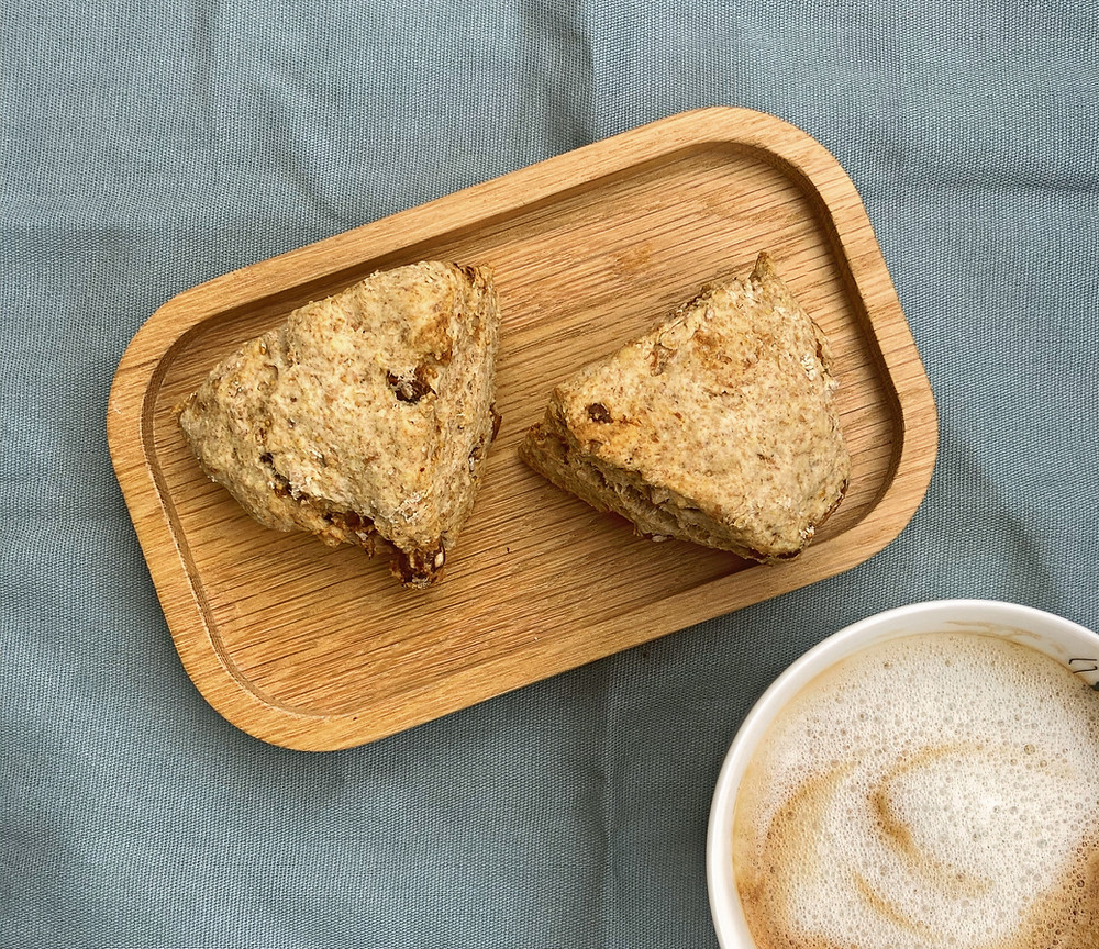 two scones on a tray, cup of coffee