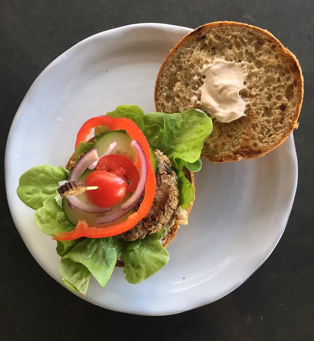 bean burger with salad on bun