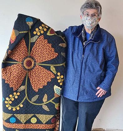 Linda Werve with raffle quilt.jpg