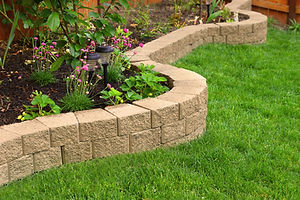 Garden beds, retaining wall, turf laying