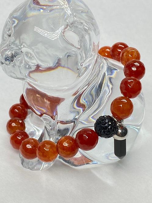 Faceted carnelian gemstone bead stretch bracelet with onyx charm