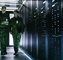 Two Military Men Walking in Data Center