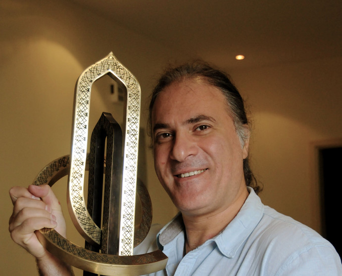 Louai Alasfahani with NBO's golf trophy which was designed by Paragon International and sculpted by celebrity Bulgarian artist Seifo