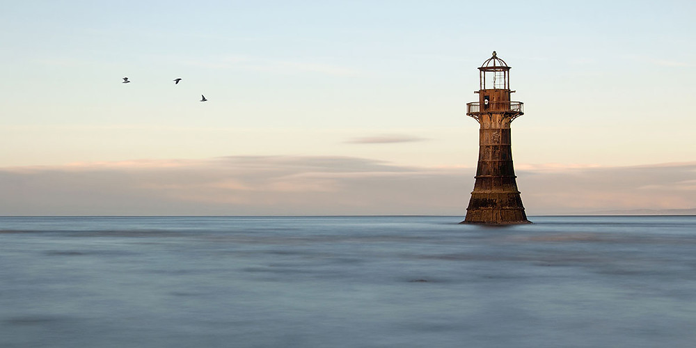 Whiteford Lighthouse aglow at sunrise