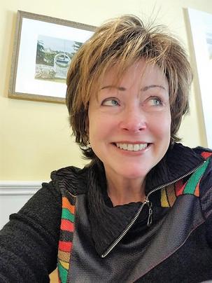 Susan Singer short auburn