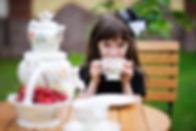 Portrait of elegant child girl in a blac