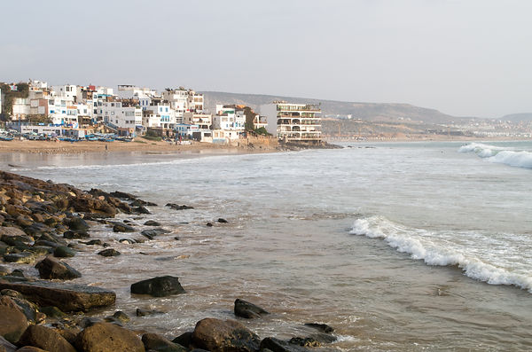 View along Taghazout with rocks and beac