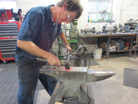Blacksmith hammering handle