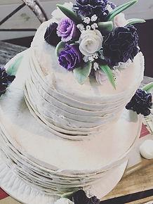 2 tier lemon birthday cake with sugar flowers