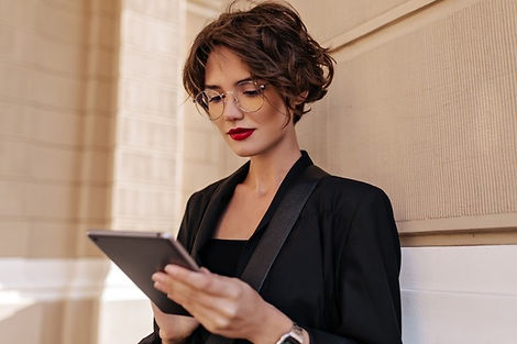 brunette-woman-with-red-lips-posing-holding-tablet-outside-stylish-woman-with-short-hair-b