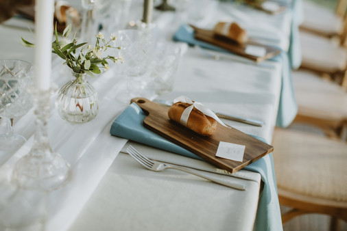 rustic wedding table ideas with bread boards and coloured napkins