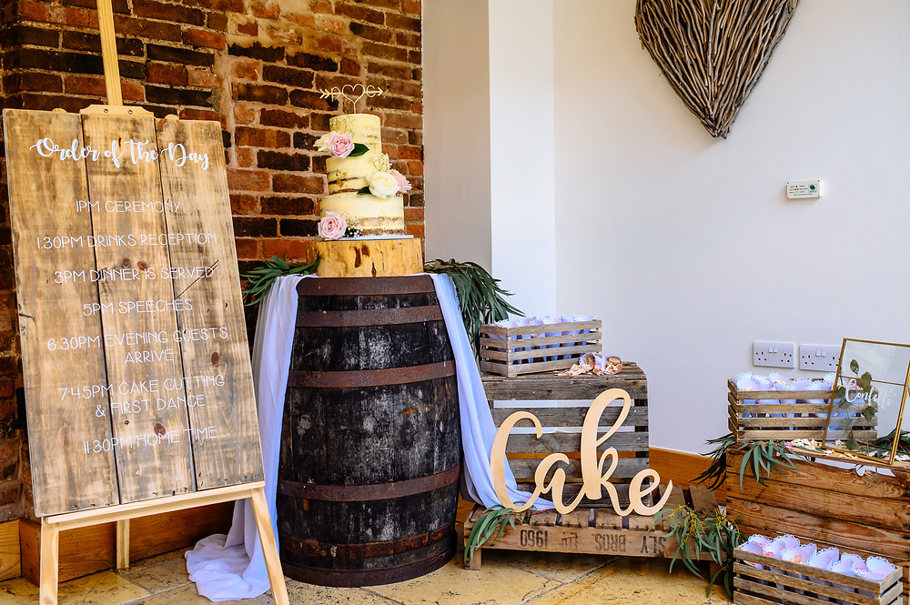 rustic barrel cake display mythe barn