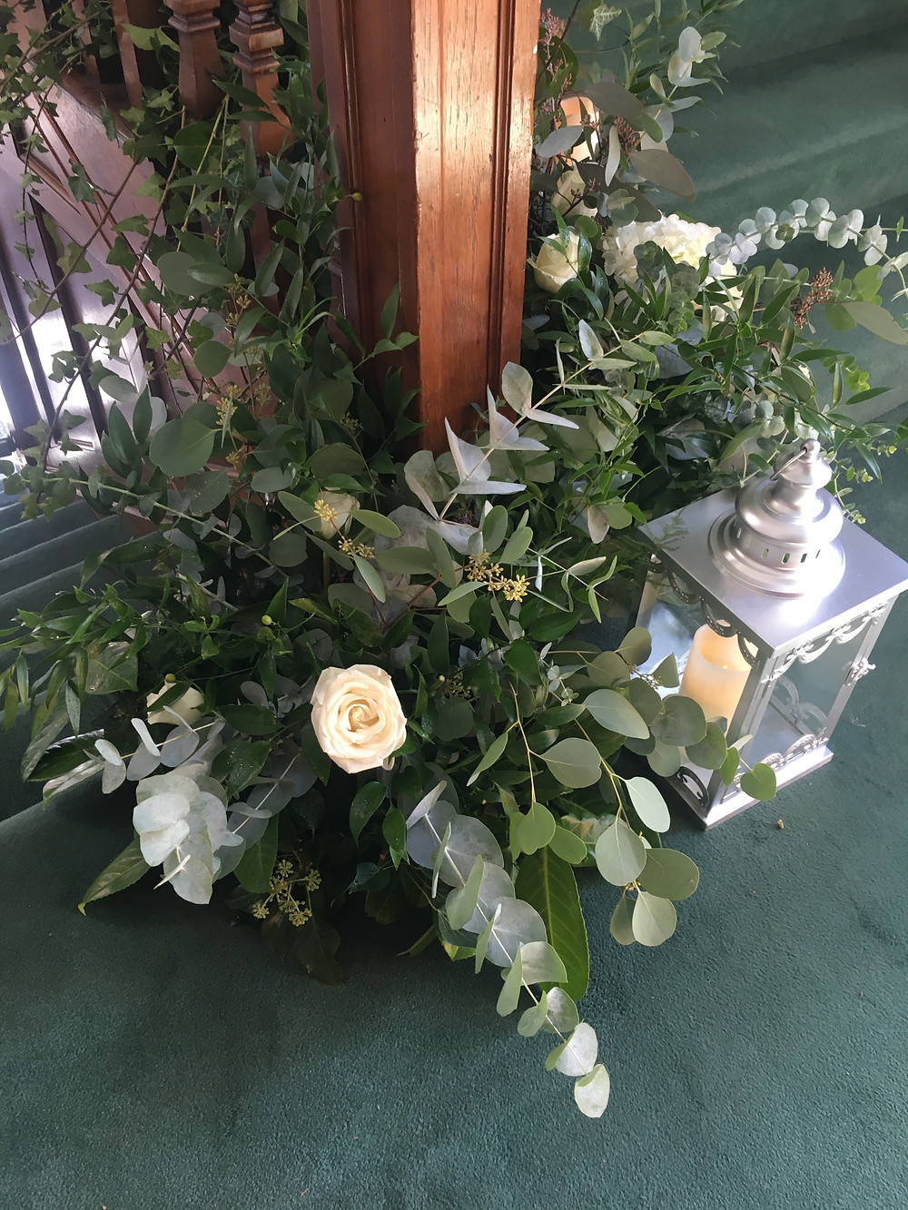 statement floral staircase arrangement silver lantern hire leicester