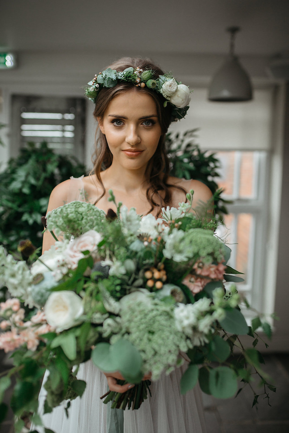 large bridal flower bouquet greenery and white foliage