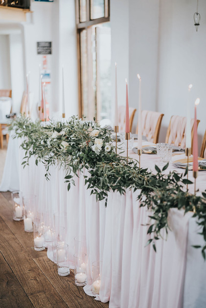 romantic wedding theme with blush pink and tall dinner candles