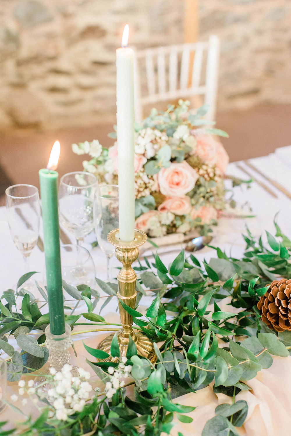 brass candlesticks on top table