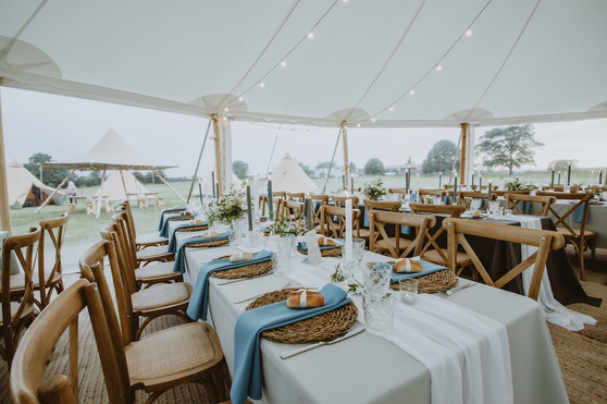 dusky blue wedding day napkin hire with seagrass charger plates
