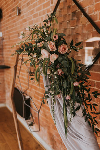 archway flowers at wedding