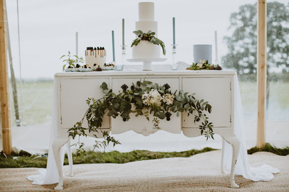 white dresser wedding cake display