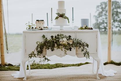 white dresser wedding cake display