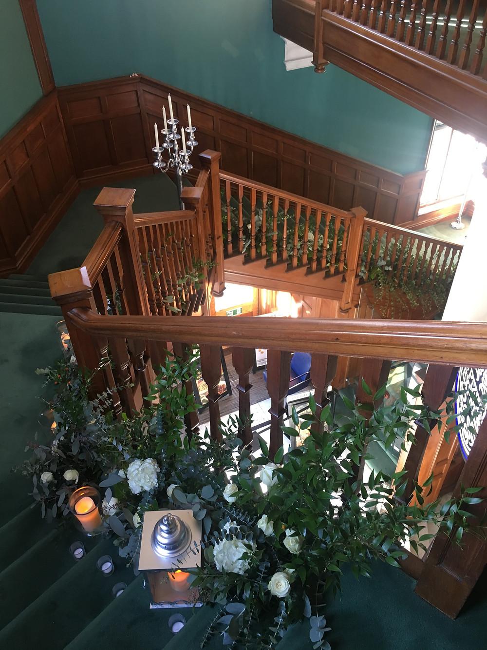 statement floral staircase arrangement grand