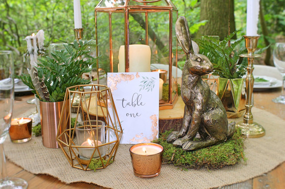 woodland wedding table centrepieces moss and lantern